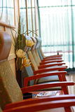 Row of chairs in a waiting room - vertical Stock Images