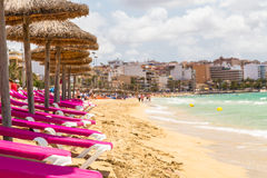 Row of chaise longues on a beach Stock Image