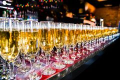 Row of champagne glasses on the bar