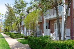 Row of charming brick townhomes in suburban neighborhood royalty free stock photography