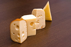 Row of cheeses Royalty Free Stock Photo