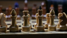 Row of chess figures close to. Row of chess figures on a chessboard close-up camera in motion stock video