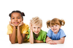Row of children. Smiling and resting together stock photography