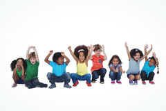 A row of children crouching down together Stock Photo
