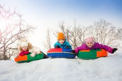 Row of children sliding down on the tubes Royalty Free Stock Photo