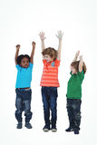 A row of children standing together with raised arms Royalty Free Stock Image