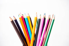 Row of childrens coloured led crayon pencils. Royalty Free Stock Photography