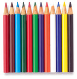 Row of childrens colouring coloring pencils. Row of colouring coloring pencils on a white background Royalty Free Stock Image