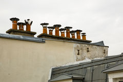 Row of Chimney Pots atop a Parisian Building Stock Photo
