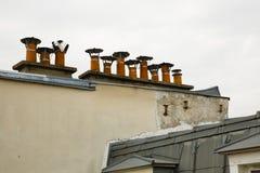 Row of Chimney Pots atop a Parisian Building Stock Photo