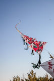 Row of chinese paper kites flying on clear blue sky Stock Photos