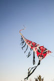 Row of chinese paper kites flying on clear blue sky Stock Images
