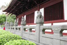 Chinese stone lion statues on balustrade,  Chinese guardian lion sculptures on balusters Royalty Free Stock Photos