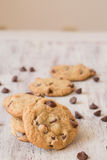 Row of Chocolate Chip Cookies Surrounded by Chips Royalty Free Stock Photography