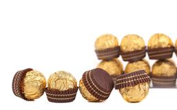 Row of chocolate gold bonbon. Stock Photos