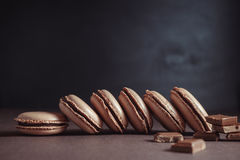 Row of Chocolate pastel brown Macarons or Macaroons stock photo
