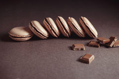 Row of Chocolate pastel brown Macarons or Macaroons stock photography