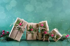 Row of  Christmas gift box and decorations. Old fashion style. On green bright background Stock Photo