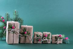 Row of  Christmas gift box and decorations. Old fashion style. On green bright background Stock Image