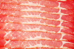Row of chunks of smoked red appetizing meat Royalty Free Stock Photo