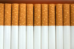 Row of cigarettes Stock Photos