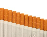 Row of cigarettes on white background Stock Photo