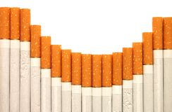 Row of cigarettes on white background Royalty Free Stock Photography