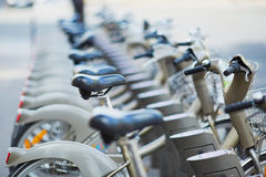 Row of city bikes for rent at docking station Stock Image