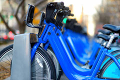 Row of city bikes for rent at docking stations Stock Photography