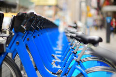 Row of city bikes for rent at docking stations Royalty Free Stock Photos