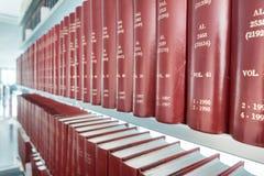 Row of classic books in modern bookshelf Royalty Free Stock Photo