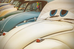 Row of classic cars. Retro styled image of a row of classic cars Royalty Free Stock Images