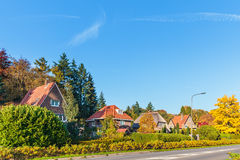 Row of classic Dutch villa's in the province of Gelderland. During autumn Stock Photo