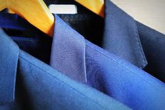Row of classic men`s suits hanging for sale Stock Photography