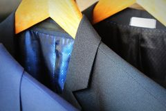 Row of classic men`s suits hanging for sale Royalty Free Stock Image