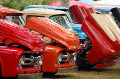 Row of Classic Trucks. Red, Orange and Blue Row of Classic Trucks Royalty Free Stock Image