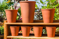 Row of clay or terracotta pots Stock Photo
