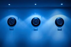 Row of clock on hte wall Stock Images