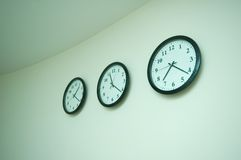 Row of clocks isolated Stock Photography