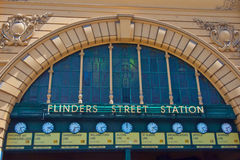 Flinders Street Railway Station,Melbourne, Australia. A row of clocks under the entrance arch display the departure times of the trains Stock Photos