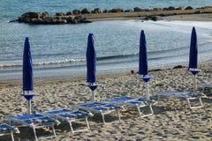 Row closed big umbrella beach Stock Photography
