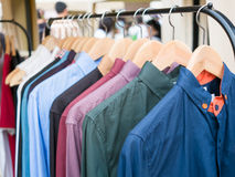 Row of cloth hangers. With shirts in the market Stock Photo