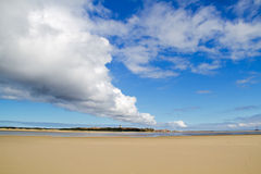 Row of clouds above beach Royalty Free Stock Images