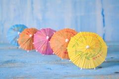 Row of cocktail umbrellas. Selective focus, copy space stock photo