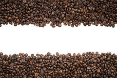Row of coffee beans isolated on white background Stock Photos