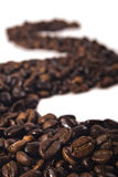 Row of coffee beans on white background Royalty Free Stock Photo