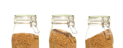 Row of coffee Jars made of glass. Three Coffee Jars Glass clip top preserve royalty free stock images