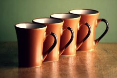 Row of coffee mugs Royalty Free Stock Photos