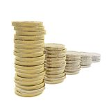 Row of coin pile stacks transforming from gold to metal. Gold depreciation as a row of coin pile stacks transforming from gold to metal isolated on white Stock Photo