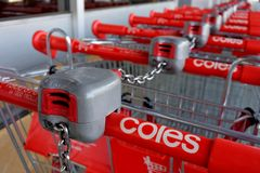 Row of Coles Supermarket trolleys. MELBOURNE - MAR 09 2019:Row of Coles Supermarket trolleys .Coles has over 100,000 employees and, together with rival stock images